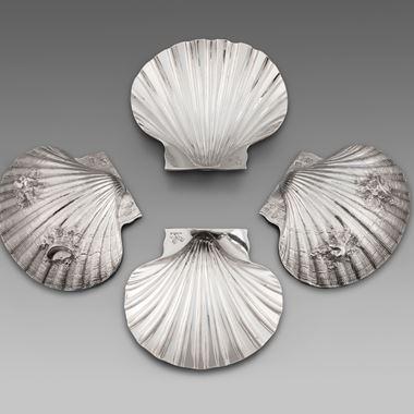 A Set of Four Paul de Lamerie Butter Shells
