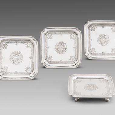 A Set of Four Square Salvers