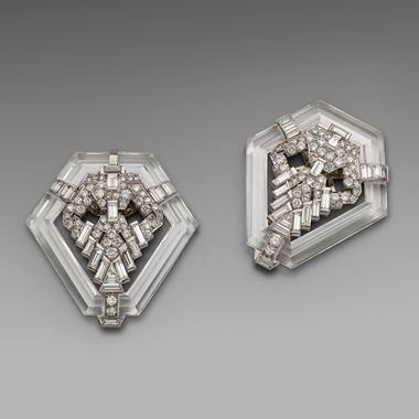 A Rare and Unusual Pair of Art Deco Carved Rock Crystal and Diamond Clip Brooches