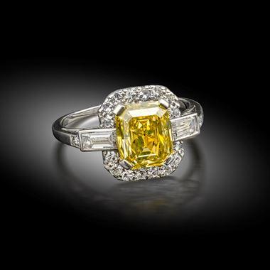 A yellow diamond and diamond ring, circa 1930