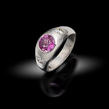 A Pink Sapphire and Diamond Gypsy Rin