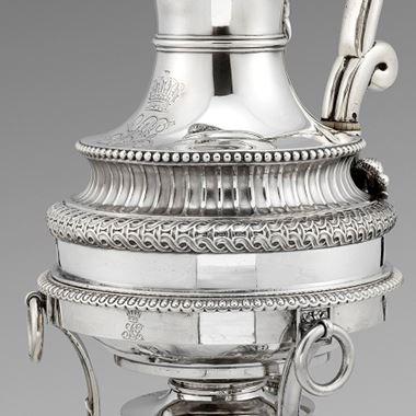 A Fine Paul Storr Coffee Pot on burner